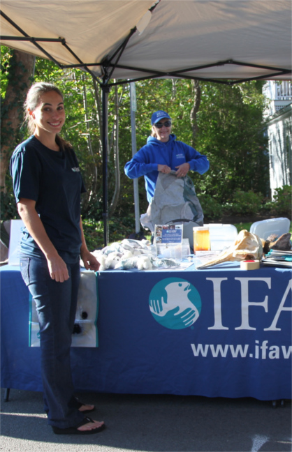 Smiling Women at IFAW booth at OysterFest