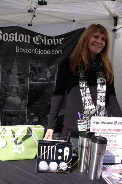 Smiling Woman at Booth for Boston Globe, OysterFest Sponsor