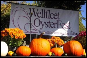 Wellfleet OysterFest 2015 stage with pumpkins and mums