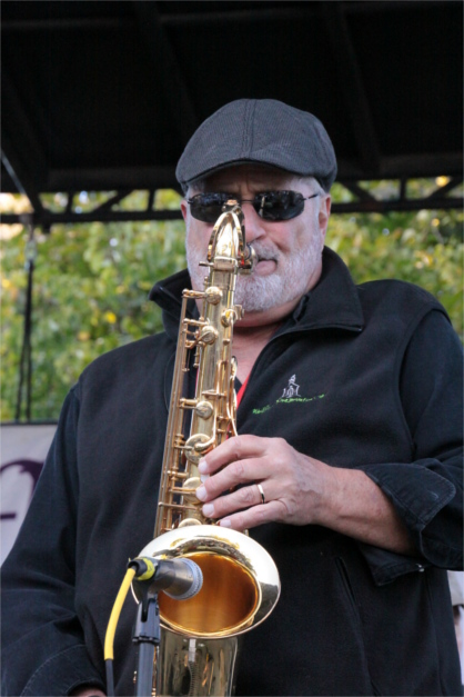 Closeup of Man Playing Saxophone On Stage at OysterFest