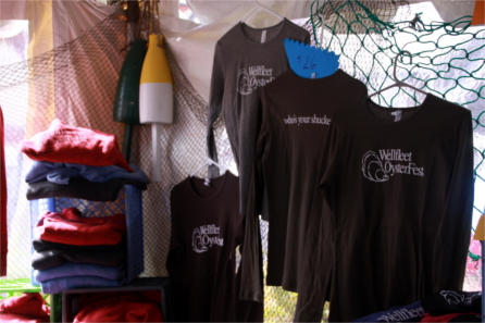 Long-sleeve Wellfleet OysterFest shirts for sale in booth at OysterFest