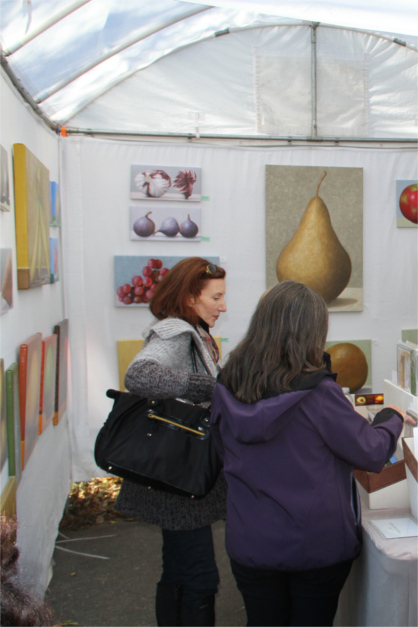 Wellfleet OysterFest Artist Booth with Paintings and two Women browsing