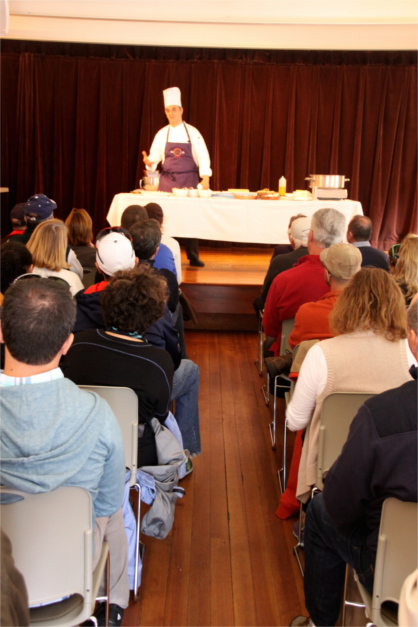 Chef speaking to audience at Wellfleet OysterFest culinary program